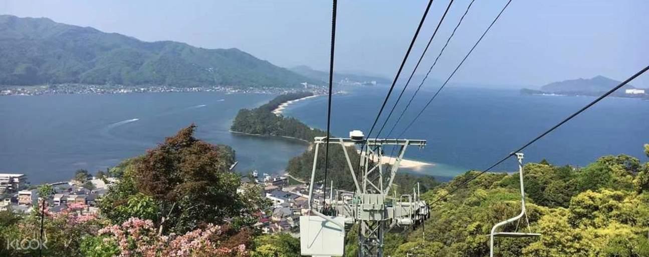 a gondola with a view of the Amanohashidate sandbar
